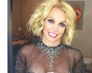 Britney spears dances topless to Mariah Carey