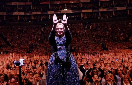 Adele talks about her beard named Larry live in concert!