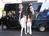 nick-jonas-and-demi-lovato-posing-outside-the-tour-bus-